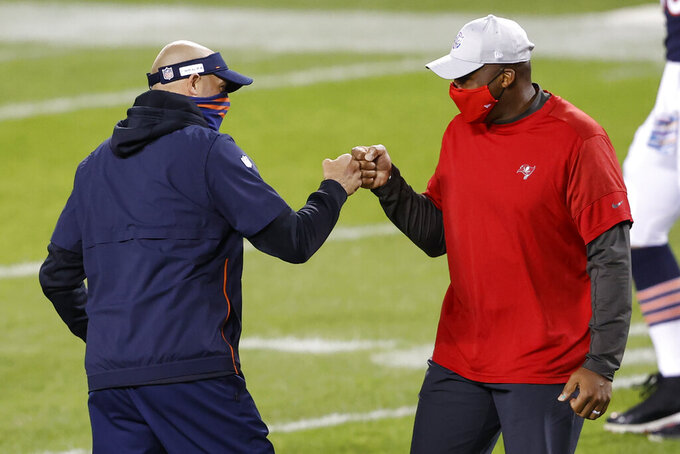 FILE - In this Oct. 8, 2020, file photo, Chicago Bears coach Matt Nagy, left, greets Tampa Bay Buccaneers defensive coordinator Todd Bowles before an NFL football game in Chicago. Bowles has long been regarded as one of the top defensive minds in the game. A Super Bowl champion as a safety in Washington, Bowles has spent the past two decades as a coach in the NFL, including a four-year stint as head coach with the Jets. (AP Photo/Kamil Krzaczynski, File)