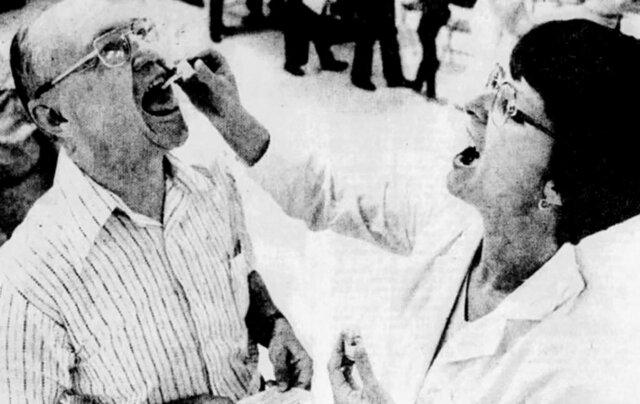 Vaccine dispenser Sue Syndansk tells Dale Carbaugh to