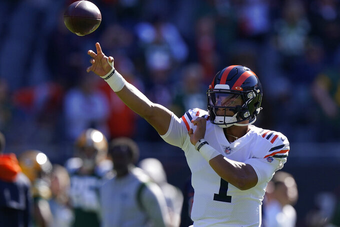 Chicago Bears quarterback Justin Fields warms up before an NFL football game against the Green Bay Packers Sunday, Oct. 17, 2021, in Chicago. (AP Photo/Nam Y. Huh)