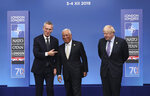 NATO Secretary General Jens Stoltenberg, left, and British Prime Minister Boris Johnson, right, welcome Portuguese Prime Minister Antonio Costa at the official arrivals for a NATO leaders meeting at The Grove hotel and resort in Watford, Hertfordshire, England, Wednesday, Dec. 4, 2019. NATO Secretary-General Jens Stoltenberg rejected Wednesday French criticism that the military alliance is suffering from brain death, and insisted that the organization is adapting to modern challenges. (AP Photo/Francisco Seco)