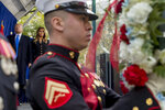 President Donald Trump and first lady Melania Trump participate in a wreath laying ceremony at the New York City Veterans Day Parade at Madison Square Park, in Washington, Monday, Nov. 11, 2019. (AP Photo/Andrew Harnik)