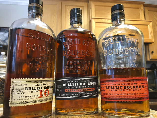 FILE - This Tuesday, Dec. 11, 2018, file photo shows bottles of Bulleit Bourbon, in Dublin, Calif. Spirits giant Diageo is going green with its newest whiskey-making venture in the Bluegrass State. Its distillery being built at Lebanon, Kentucky,  is expected to be carbon neutral — a first for the London-based company, it announced Monday, June 29, 2020. The $130 million distillery, which will produce Bulleit bourbon, is expected to be fully operational in 2021. (AP Photo/Ben Margot, FIle)