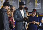 Mahershala Ali, center, wears a hat to promote his new movie
