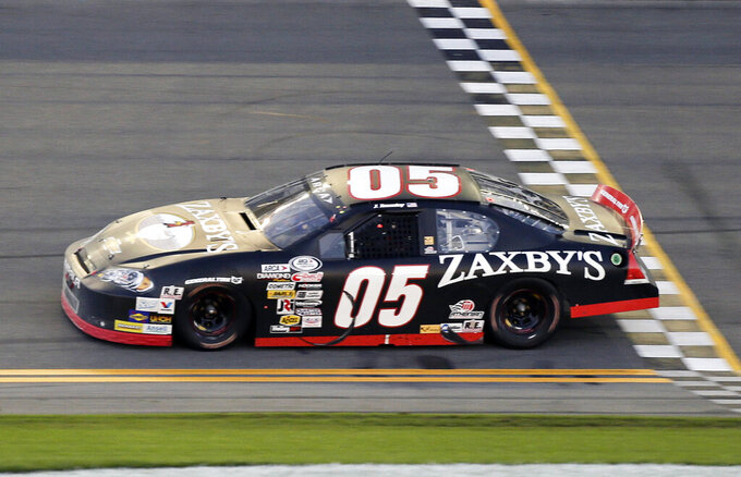 FILE - In this Feb. 13, 2016, file photo, John Wes Townley crosses the finish line to win the ARCA series auto race at Daytona International Speedway in Daytona Beach, Fla. Former NASCAR driver Townley was killed Saturday, Oct. 2, 2021, in a shooting in Georgia that also wounded a woman, investigators said. Townley, 31, died in the shooting in a neighborhood around 9 p.m., Athens-Clarke County Coroner Sonny Wilson told the Athens Banner-Herald. (AP Photo/Terry Renna, File)
