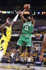 FILE - In this April 21, 2019, file photo, Boston Celtics guard Kyrie Irving (11) shoots over Indiana Pacers guard Darren Collison (2) during the first half of Game 4 of an NBA basketball first-round playoff series in Indianapolis. Just three seasons ago, the Brooklyn Nets were the worst team in the NBA. On Sunday, June 30, 2019, they were the story of the league. They agreed to deals with superstars Kevin Durant and Kyrie Irving as part of a sensational start to free agency, giving the longtime No. 2 team in New York top billing in the Big Apple. (AP Photo/Michael Conroy, File)