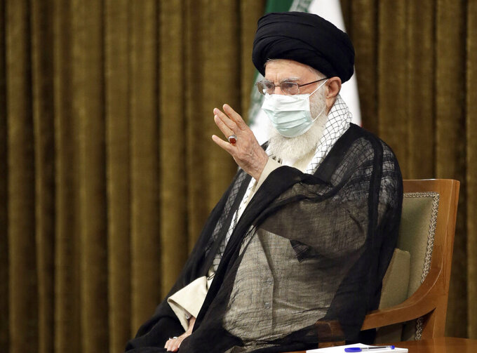 """In this photo released by the official website of the office of the Iranian supreme leader, Supreme Leader Ayatollah Ali Khamenei speaks in farewell meeting with outgoing President Hassan Rouhani's administration in Tehran, Iran, Wednesday, July 28, 2021. Iran's supreme leader  called on Wednesday the U.S. """"stubborn"""" installed nuclear talks in Vienna for discussing Tehran's missiles and regional influence. (Office of the Iranian Supreme Leader via AP)"""