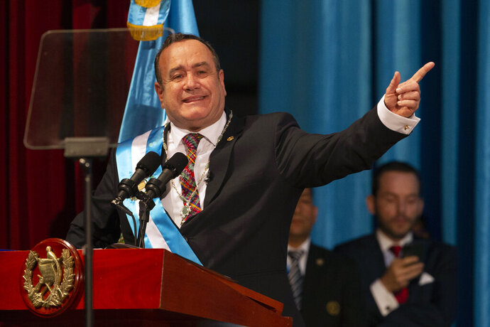 Alejandro Giammattei delivers his speech after being sworn-in as president of Guatemala at the National Theater in Guatemala City, Tuesday, Jan. 14, 2020. Giammattei, a conservative physician opposed to gay marriage and abortion, became Guatemala's new president, while the country's outgoing leader exits amid swirling corruption accusations. (AP Photo/Moises Castillo)