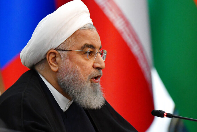 Iranian President Hassan Rouhani speaks during a session of the Shanghai Cooperation Organization summit in Bishkek, Kyrgyzstan, Friday, June 14, 2019. The Shanghai Cooperation Organization is a security alliance that brings together Russia, China, India, Pakistan along with ex-Soviet Central Asia nations of Kazakhstan, Kyrgyzstan, Tajikistan and Uzbekistan. (AP Photo/Vladimir Voronin)