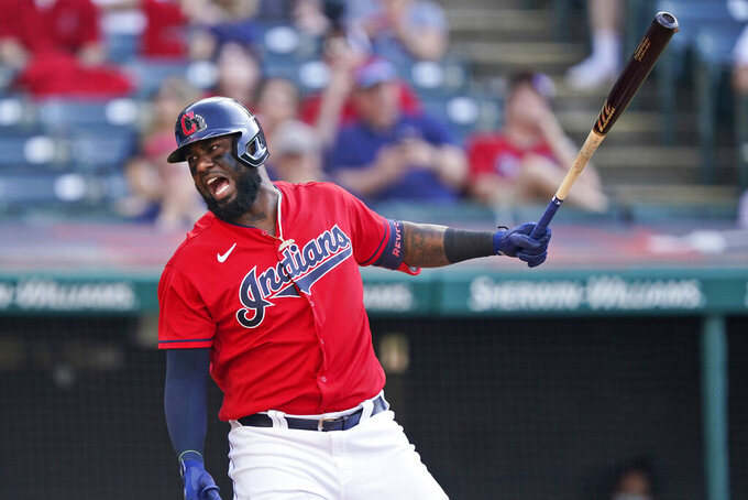 Cleveland Indians' Franmil Reyes reacts after swinging in the sixth inning of a baseball game against the Minnesota Twins, Saturday, May 22, 2021, in Cleveland. Reyes left the game with an injury. (AP Photo/Tony Dejak)