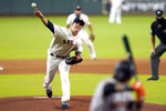 Houston Astros starting pitcher Zack Greinke, left, throws to San Francisco Giants' Wilmer Flores during the first inning of a baseball game Wednesday, Aug. 12, 2020, in Houston. (AP Photo/David J. Phillip)