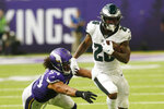 Philadelphia Eagles running back Miles Sanders (26) runs from Minnesota Vikings middle linebacker Eric Kendricks, left, during the first half of an NFL football game, Sunday, Oct. 13, 2019, in Minneapolis. (AP Photo/Jim Mone)