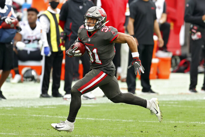 Tampa Bay Buccaneers strong safety Antoine Winfield Jr. (31) runs with the football after a recoving a fumble by the Atlanta Falcons during the first half of an NFL football game Sunday, Jan. 3, 2021, in Tampa, Fla. (AP Photo/Mark LoMoglio)