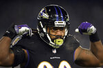 FILE - In this Dec. 30, 2018, file photo, Baltimore Ravens outside linebacker Za'Darius Smith gestures in the first half of an NFL football game against the Cleveland Browns in Baltimore. The Green Bay Packers agreed to $183 million worth of contracts Tuesday, March 12, 2019, with edge rusher Za'Darius Smith, linebacker Preston Smith, safety Adrian Amos and offensive lineman Billy Turner. The signings should improve a defense that ranked 18th in the NFL in 2018 and add some more protection for quarterback Aaron Rodgers. (AP Photo/Nick Wass, File)