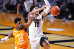Tennessee's Victor Bailey Jr. (12) blocks a shot attempt by Vanderbilt's Myles Stute (10) in the first half of an NCAA college basketball game Wednesday, Feb. 24, 2021, in Nashville, Tenn. (AP Photo/Mark Humphrey)