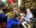 Georgia head coach Kirby Smart signs autographs as her arrives for the Southeastern Conference NCAA college football Media Days in Hoover, Ala., Tuesday, July 16, 2019.  (Curtis Compton/Atlanta Journal-Constitution via AP)