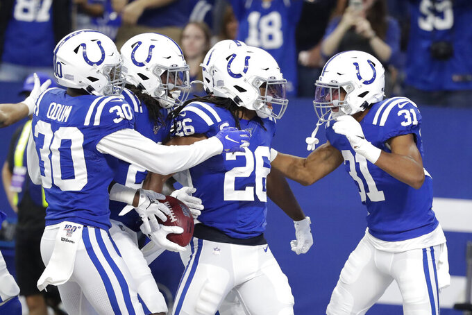 Indianapolis Colts strong safety Clayton Geathers (26) celebrates with teammates after an interception during the first half of an NFL football game against the Atlanta Falcons, Sunday, Sept. 22, 2019, in Indianapolis. (AP Photo/Michael Conroy)