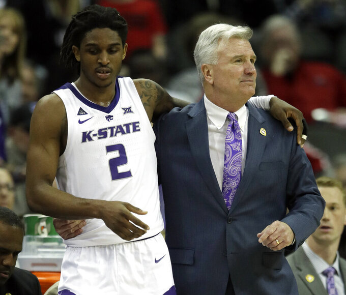 Kansas State head coach Bruce Weber, right, sends in guard Cartier Diarra (2) during the second half of an NCAA college basketball game against TCU in the quarterfinals of the Big 12 conference tournament in Kansas City, Mo., Thursday, March 14, 2019. (AP Photo/Orlin Wagner)