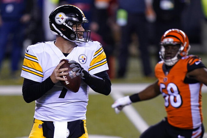 Pittsburgh Steelers quarterback Ben Roethlisberger (7) looks to throw during the first half of an NFL football game against the Cincinnati Bengals, Monday, Dec. 21, 2020, in Cincinnati. (AP Photo/Bryan Woolston)
