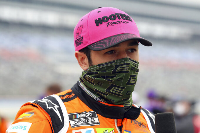 Chase Elliott (9) waits on the grid before a NASCAR Cup Series auto race at Texas Motor Speedway in Fort Worth, Texas, Sunday, Oct. 25, 2020. (AP Photo/Richard W. Rodriguez)