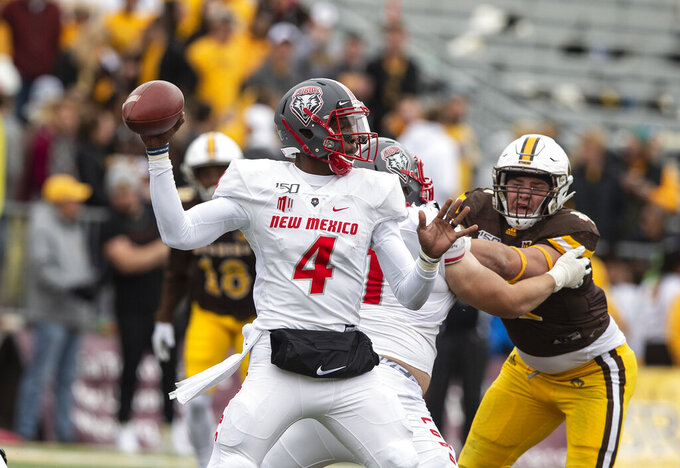 FILE - In this Oct. 19, 2019 file photo, New Mexico quarterback Sheriron Jones (4) throws a pass against Wyoming during an NCAA college football game in Laramie, Wy. New Mexico has suspended Jones indefinitely from the team for undisclosed reasons. (AP Photo/Michael Smith, File)