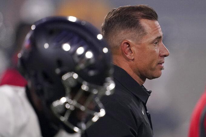 UNLV head coach Marcus Arroyo watches his team prior to an NCAA college football game against Arizona State, Saturday, Sept. 11, 2021, in Tempe, Ariz. (AP Photo/Matt York)