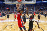 New Orleans Pelicans center Derrick Favors (22) slam dunks in front of Houston Rockets center Clint Capela (15) in the first half of an NBA basketball game in New Orleans, Monday, Nov. 11, 2019. (AP Photo/Gerald Herbert)