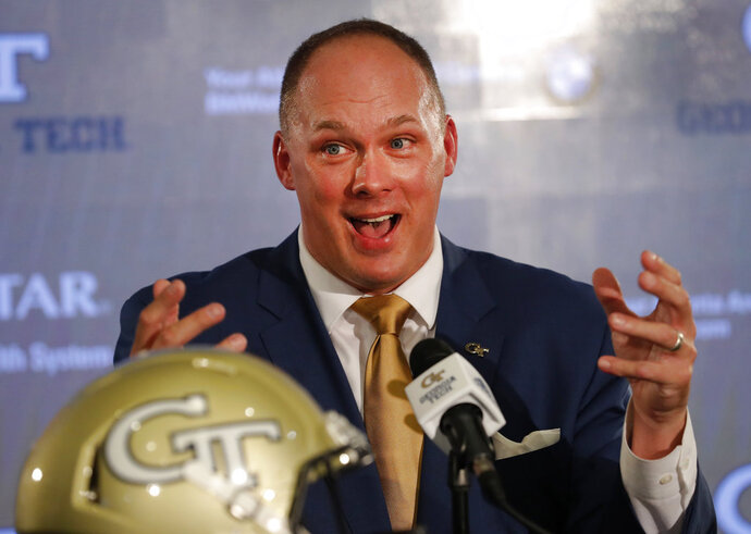Newly hired Georgia Tech football coach Geoff Collins speaks during a news conference Friday, Dec. 7, 2018, in Atlanta. (AP Photo/John Bazemore)