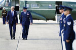 President Joe Biden speaks with Colonel William (Chris) McDonald, Vice Commander, 89th Air Wing before boarding Air Force One for a trip to New York to attend the United Nations General Assembly, Monday, Sept. 20, 2021, at Andrews Air Force Base, Md. (AP Photo/Evan Vucci)