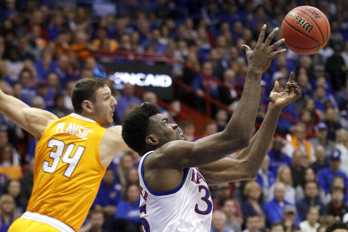 Kansas center Udoka Azubuike, right, rebounds against Tennessee forward Uros Plavsic, left, during the first half of an NCAA college basketball game in Lawrence, Kan., Saturday, Jan. 25, 2020. (AP Photo/Orlin Wagner)