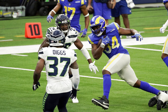Los Angeles Rams running back Malcolm Brown (34) scores against the Seattle Seahawks during the first half of an NFL football game Sunday, Nov. 15, 2020, in Inglewood, Calif. (AP Photo/Jae C. Hong )