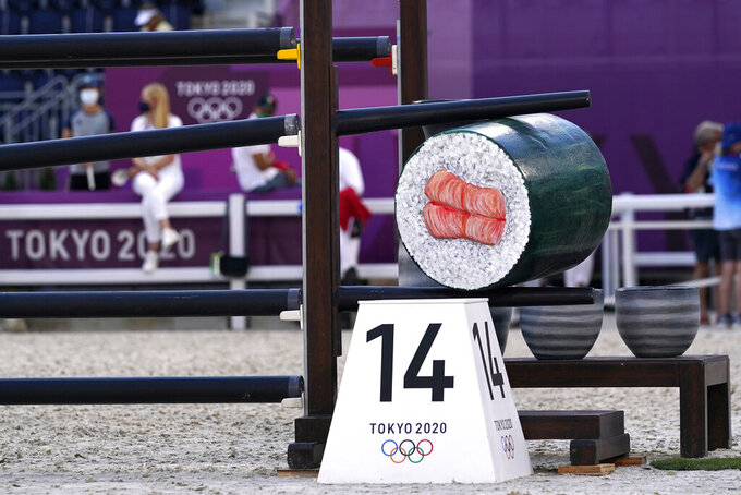A jump stylized with a sushi roll design is in place before competition begins in the equestrian jumping team qualifying at Equestrian Park in Tokyo at the 2020 Summer Olympics, Friday, Aug. 6, 2021, in Tokyo, Japan. (AP Photo/Carolyn Kaster)