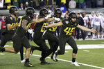 Oregon kicker Camden Lewis, right, begins the celebration after his game winning field goal against Washington State in an NCAA college football game Saturday, Oct. 26, 2019, in Eugene, Ore. (AP Photo/Chris Pietsch)