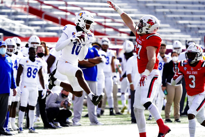 San Jose State wide receiver Tre Walker (10) makes a catch in front of Ball State linebacker Jimmy Daw (27) and Amechi Uzodinma II (3) in the first half of the Arizona Bowl NCAA college football game, Thursday, Dec. 31, 2020, in Tucson, Ariz. (AP Photo/Rick Scuteri)