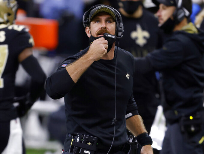 FILE - In this Nov. 22, 2020, file photo, New Orleans Saints defensive line coach Ryan Nielsen looks on during an NFL football game against the Atlanta Falcons in New Orleans. A person familiar with the situation says Nielsen has agreed in principle to become LSU's next defensive coordinator. The person spoke to The Associated Press on condition of anonymity on Monday, Jan. 18, 2021, because some contractual details were still pending. (AP Photo/Tyler Kaufman, File)