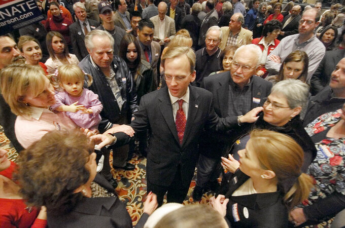 FILE - In this Nov. 2, 2004 file photo, Oklahoma Democratic congressman Brad Carson thanks supporters after giving his concession speech at his watch party at a hotel in Tulsa, Okla. Carson lost to Republican Tom Coburn. The University of Tulsa has named Carson as its next president. The university's Board of Trustees voted Monday, April 5, 2020, to select Carson to become the private university's 21st president. (AP Photo/The Oklahoman, Paul Hellstern File)