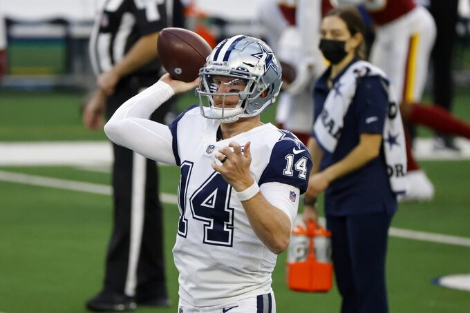 Dallas Cowboys quarterback Andy Dalton (14) warms up before an NFL football game against the Washington Football Team in Arlington, Texas, Thursday, Nov. 26, 2020. (AP Photo/Ron Jenkins)