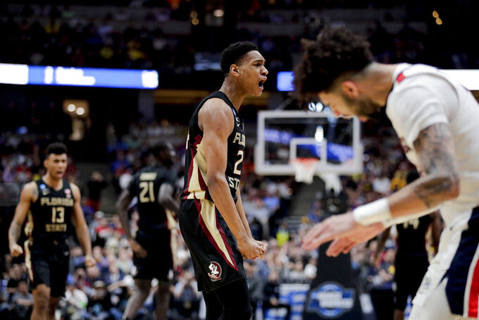 Florida State guard Devin Vassell celebrates after scoring against Gonzaga during the second half an NCAA men's college basketball tournament West Region semifinal Thursday, March 28, 2019, in Anaheim, Calif. (AP Photo/Jae C. Hong)