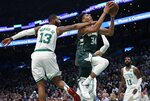 Milwaukee Bucks' Giannis Antetokounmpo (34) shoots against Boston Celtics' Marcus Morris (13) during the first half of Game 4 of a second-round NBA basketball playoff series in Boston, Monday, May 6, 2019. (AP Photo/Michael Dwyer)