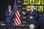 Atlanta Gov. Brian Kemp, left, joins Vice President Mike Pence at a roundtable discussion with restaurant executives at the Waffle House Headquarters, Friday, May 22, 2020, in Atlanta. (John Spink/Atlanta Journal-Constitution via AP)