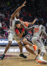 Virginia Tech guard Tyrece Radford (23) and Virginia Tech guard Landers Nolley II (2) steal the ball from Gardner-Webb guard Jose Perez (5) during the first half of an NCAA college basketball game Sunday, Dec. 15, 2019 in Blacksburg, Va. (Don Petersen/Roanoke Times via AP)