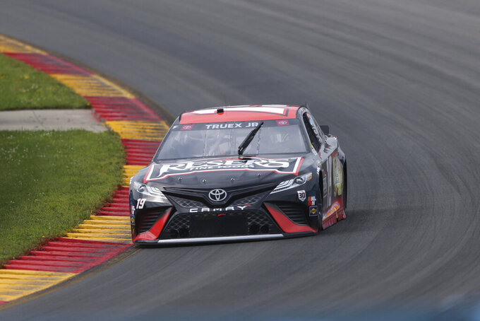 Martin Truex Jr. (19) drives up the esses during a NASCAR Cup Series auto race in Watkins Glen, N.Y., on Sunday, Aug. 8, 2021. (AP Photo/Joshua Bessex)
