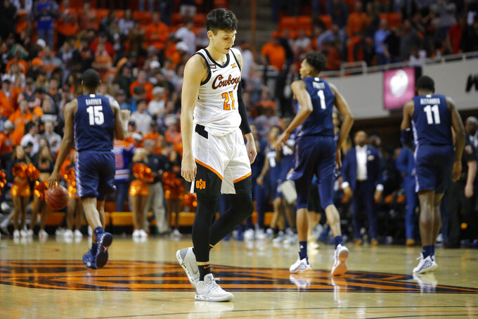 Oklahoma State's Lindy Waters III (21) walks off the court after the team's NCAA college basketball game against Georgetown in Stillwater, Okla., Wednesday, Dec. 4, 2019. (Bryan Terry/The Oklahoman via AP)