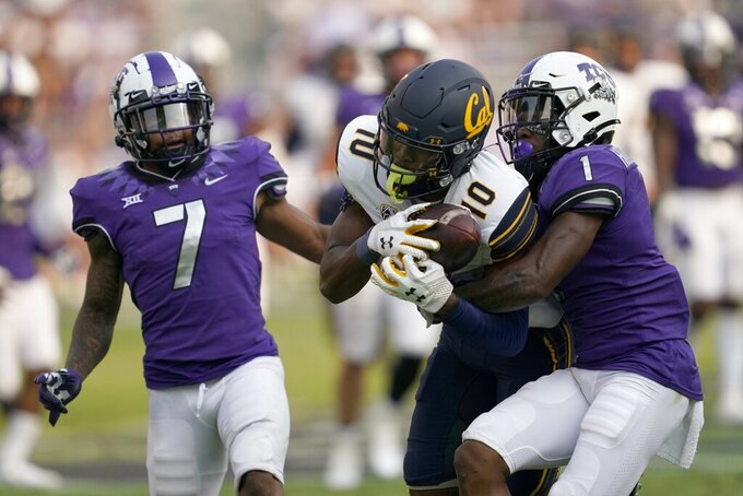 California wide receiver Jeremiah Hunter (10) catches a pass between TCU safety T.J. Carter (7) and cornerback Tre'Vius Hodges-Tomlinson (1) in the second half of an NCAA college football game in Fort Worth, Texas, Saturday, Sept. 11, 2021. (AP Photo/Tony Gutierrez)