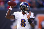 Baltimore Ravens quarterback Lamar Jackson passes during the first half of NFL football game against the Cincinnati Bengals, Sunday, Nov. 10, 2019, in Cincinnati. (AP Photo/Gary Landers)