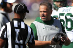 Baylor head coach Matt Rhule, right, talks with line judge Quentin Givens, left, during the first half of an NCAA college football game against Kansas State in Manhattan, Kan., Saturday, Oct. 5, 2019. (AP Photo/Orlin Wagner)