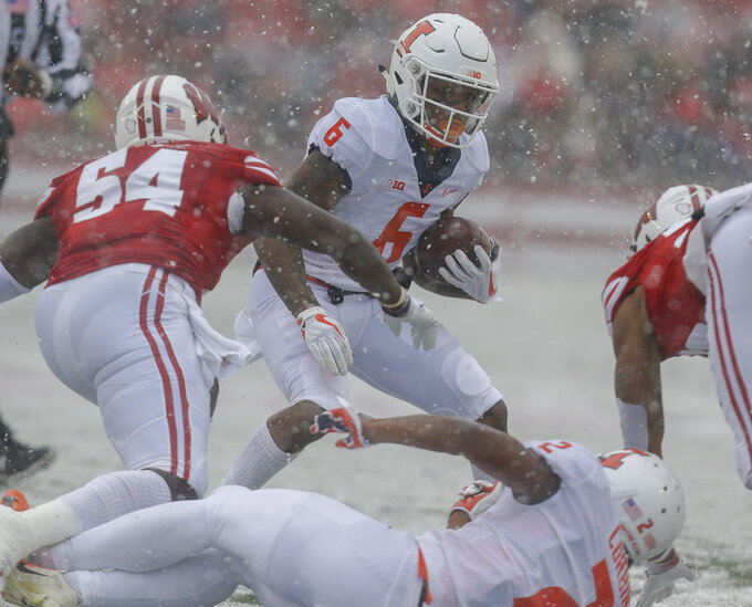 Illinois wide receiver Dominic Stampley runs against Wisconsin linebacker Chris Orr (54) during the first half of an NCAA college football game Saturday, Oct. 20, 2018, in Madison, Wis. (AP Photo/Andy Manis)
