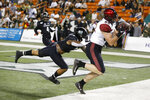 San Diego State tight end Daniel Bellinger (88) pulls in a pass next to Hawaii linebacker Jeremiah Pritchard (2), but out of bound during the first half of an NCAA college football game Saturday, Nov. 23, 2019, in Honolulu. (AP Photo/Marco Garcia)