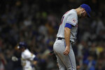 New York Mets' Tylor Megill, right, reacts after giving up a solo home run to Milwaukee Brewers' Christian Yelich during the third inning of a baseball game, Friday, Sept. 24, 2021, in Milwaukee. (AP Photo/Aaron Gash)