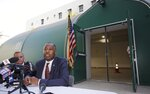 U.S. Department of Housing and Urban Development secretary Ben Carson, right, with Union Rescue Mission CEO, Andy Bales takes questions from the media as he visits the Union Rescue Mission in Skid Row area of downtown Los Angeles Wednesday, Sept. 18, 2019. On arrival in California on Tuesday, Trump told reporters aboard Air Force One he will do
