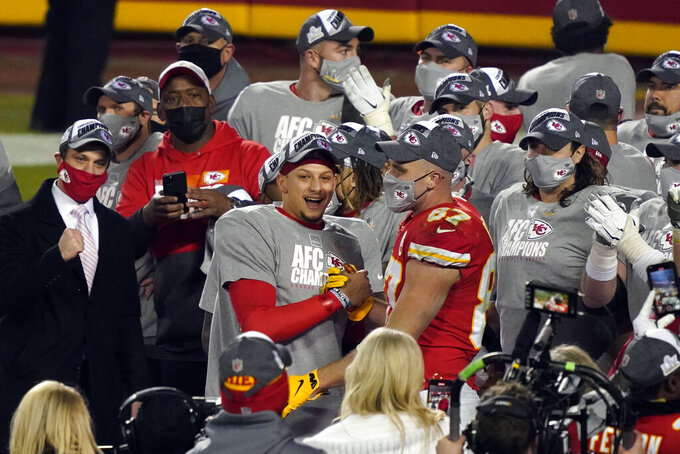 Kansas City Chiefs quarterback Patrick Mahomes celebrates with Kansas City Chiefs tight end Travis Kelce (87) and teammates after the AFC championship NFL football game against the Buffalo Bills, Sunday, Jan. 24, 2021, in Kansas City, Mo. The Chiefs won 38-24. (AP Photo/Jeff Roberson)
